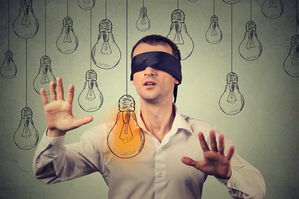 blindfolded man with lightbulb