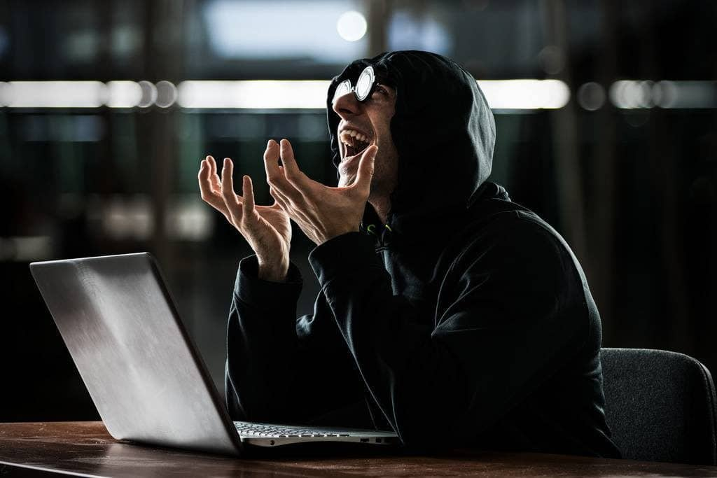 man in front of computer